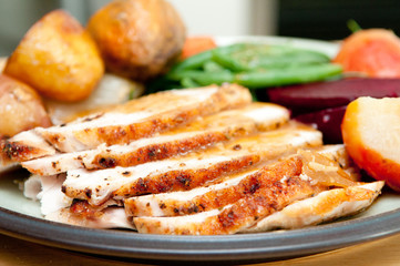 sliced turkey with roasted potatoes, sugar beets, yams