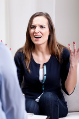 Angry young woman during psychotherapy