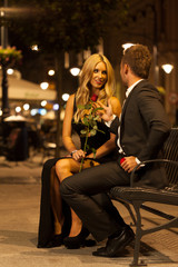 Elegant woman and a handsome man on a date