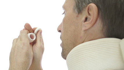Male In Neck Brace Over the Shoulder Pills