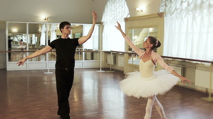 Ballet dancing in the studio, couple practicing dancing moves