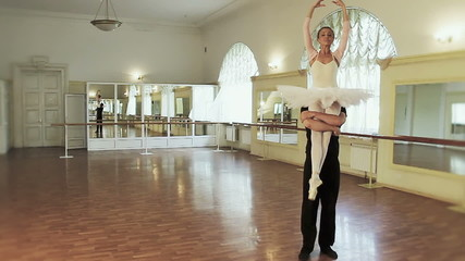 Male female practicing ballet moves in the gym, slow motion