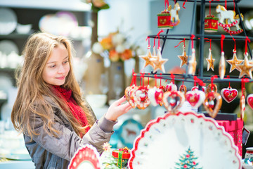 Girl selecting Christmas decorations