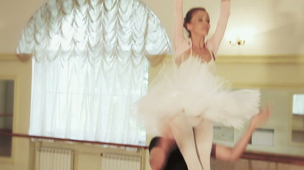 Elderly ballerina performing ballet moves with partner, slow-mo