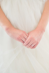 Young bride's hands with engagement ring