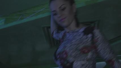 Attractive girl table dancing at bar, erotic Go Go dancer