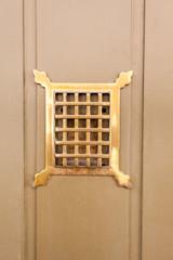 see-through hole in door