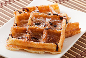 Waffles with chocolate and powdered sugar