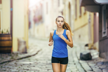 Young woman running in city center
