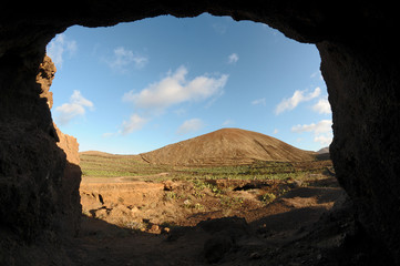 Cave near a volcano in the desert
