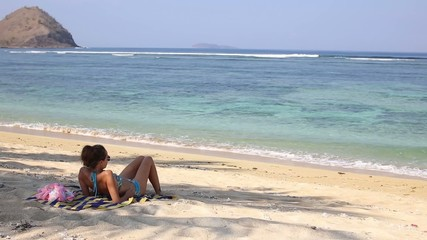 Young woman on the tropical beach