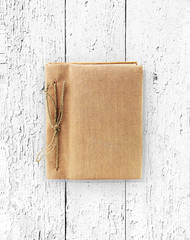 old book isolated on Wooden grunge texture