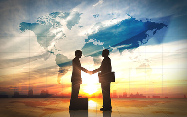 Two business man shake hand silhouettes city with world maps