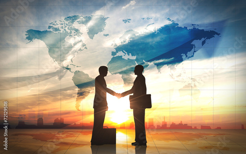 canvas print picture Two business man shake hand silhouettes city with world maps
