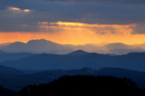Sunset over color mountain silhouette.