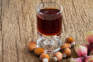 Hazelnut liqueur in a glass and hazelnuts