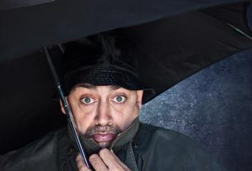 worried man under umbrella