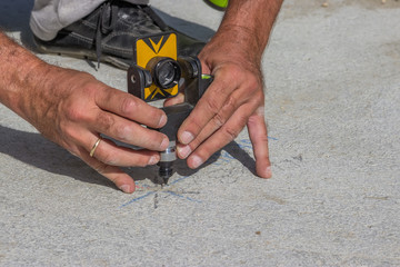 Total station prism with survey worker hands 2