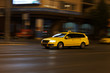yellow taxi moves on the night city street - 72133134
