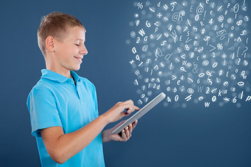 young boy using tablet,school learning or technology concept