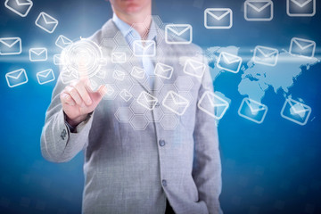 Business man pressing e- mail  button on digital virtual screen
