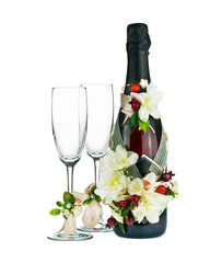 Champagne Bottle and Glass with Wedding Decoration of Flower Arr