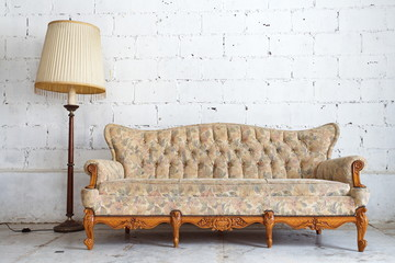 vintage yellow luxury armchair and white brick wall