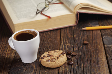 Coffee cup and old book
