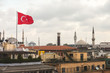 Turkish Flag and Istanbul Rooftops View with Mosque on Backgroun