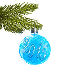 2015 on a blue Christmas ball hanging on a tree