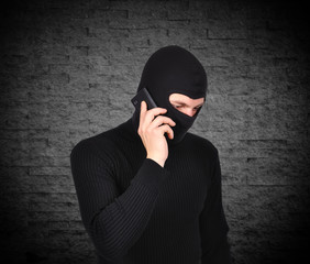 robber talking on phone