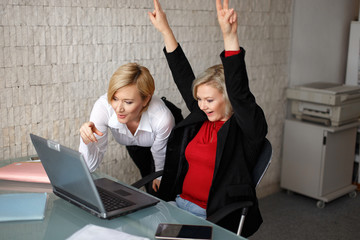 Successful blonde young managers in office