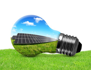 Solar panels in light bulb on white background