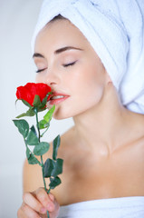 Sensual woman smelling a red rose