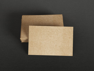 Cardboard business cards on textile background