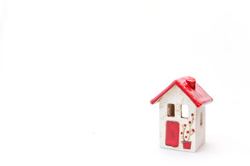 Red and white house on white background