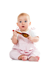 Baby with spoon in hand