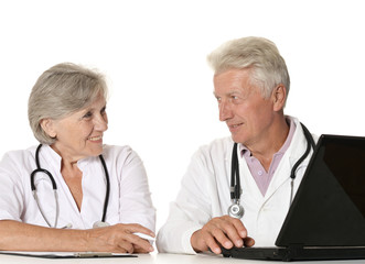 Elderly doctors with a laptop