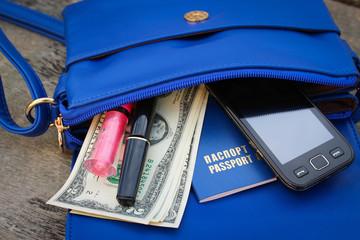 Blue women's purse. Things from open purse.