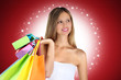 Christmas shopping woman with colorful bags on red background