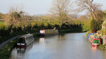 Canal scene with narrowboats and cyclists