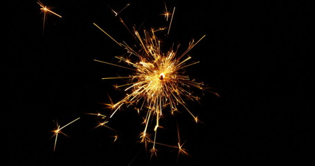 4K - Sparkler over Black Background
