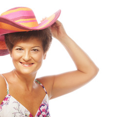 mature happy woman with pink hat