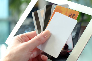 Young business woman holding   credit cards . On-line shopping o
