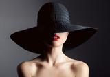 Beautiful woman in hat. Retro fashion. Dark Background. - 72143153