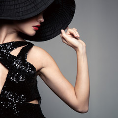 Beautiful woman in hat. Retro fashion.