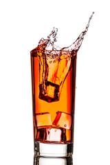 Ice splashing in cup of tea