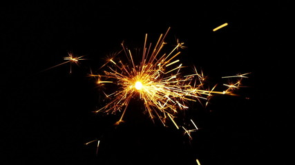 Sparkler over Black Background. Slow-mo