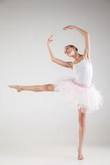 Ballerina in classical tutu over white background