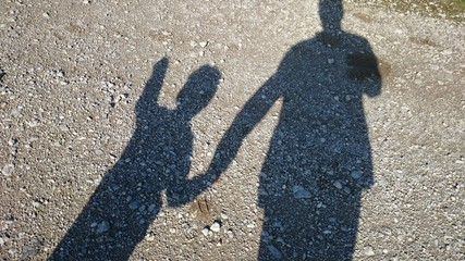 Shadow man and child